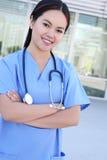 Pretty Asian Nurse at Hospital Stock Photo