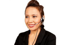 Pretty asian receptionist with headset Royalty Free Stock Photography