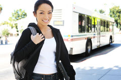 Pretty Asian Student Getting off Bus royalty free stock photo