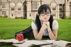 Pretty Asian student learns at park Royalty Free Stock Image