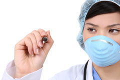 Pretty Asian Surgeon Writing Royalty Free Stock Images