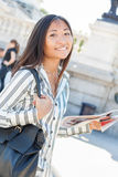 Pretty asian tourist holding a map Royalty Free Stock Image