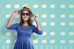 Pretty asian tourist woman with hat and blue shirt stock photos