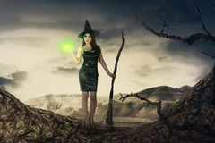 Pretty asian witch woman with magic broom emit light Stock Image