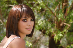 Pretty Asian Woman. Closeup portrait of a very beautiful Asian woman in  a natural outdoor environmant Royalty Free Stock Photos