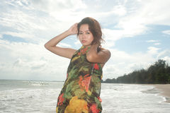 Pretty Asian woman on the beach with joy on her fabric . Stock Photography