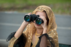 Pretty Asian woman with binoculars . Stock Photography