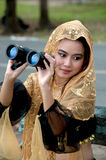 Pretty Asian woman with binoculars . Stock Photos