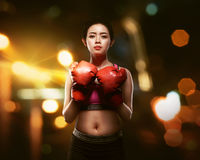 Pretty asian woman with boxing gloves in fighting posing Royalty Free Stock Image