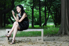 Pretty asian woman on cell phone Royalty Free Stock Photography