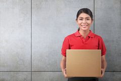 Pretty Asian Woman Courier With Cardboard Box Royalty Free Stock Photography