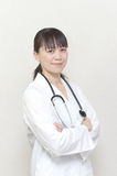 Pretty Asian woman doctor Stock Photography