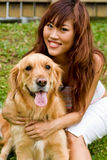 Pretty asian woman with dog stock photos