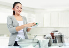 Asian woman doing house work Royalty Free Stock Photography