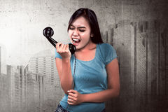 Pretty asian woman get angry on the phone Royalty Free Stock Images