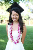 Pretty Asian Woman Graduation. A pretty young asian woman outside at college graduation Royalty Free Stock Photos