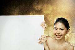 Pretty asian woman holding blank banner Royalty Free Stock Photos