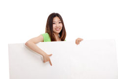 Pretty asian woman holding a penel and show thumb Stock Images