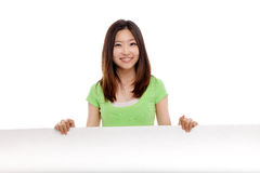 Pretty asian woman holding a penel and show thumb Stock Photography