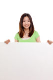 Pretty asian woman holding a penel and show thumb Royalty Free Stock Image