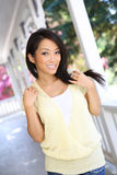 Pretty Asian Woman at Home Stock Images