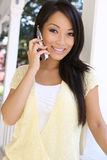 Pretty Asian Woman at Home on Phone Royalty Free Stock Images