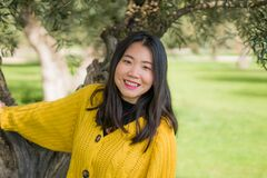 Free Pretty Asian Woman In City Park - Lifestyle Portrait Of Young Beautiful And Happy Chinese Girl Playful By A Tree Enjoying Enjoying Royalty Free Stock Photos - 212997708