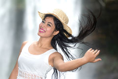 A pretty Asian woman jerking her hair. Royalty Free Stock Image
