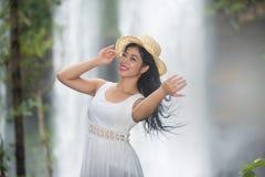 A pretty Asian woman jerking her hair. Stock Photos