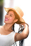 A pretty Asian woman jerking her hair. Royalty Free Stock Photo