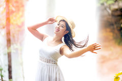A pretty Asian woman jerking her hair. Stock Images