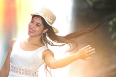 A pretty Asian woman jerking her hair. Royalty Free Stock Images