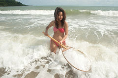 Pretty Asian woman joyfully with fishing scoop net . Royalty Free Stock Image