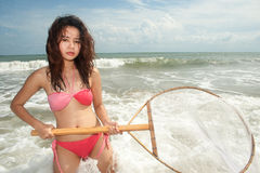 Pretty Asian woman joyfully with fishing scoop net . Stock Images