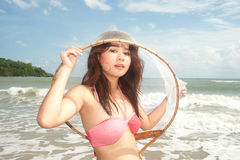 Pretty Asian woman joyfully with fishing scoop net . Royalty Free Stock Photos