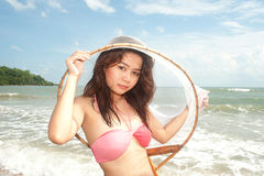 Pretty Asian woman joyfully with fishing scoop net . Stock Photo