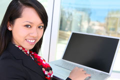 Pretty Asian Woman with Laptop Royalty Free Stock Photos