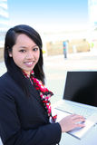 Pretty Asian Woman with Laptop Royalty Free Stock Photography