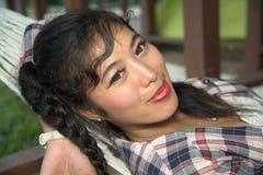 Pretty Asian Woman lying on Hammock . Stock Image