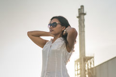 Pretty asian woman near factory Royalty Free Stock Images