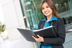 Pretty Asian Woman at Office Building Stock Photo