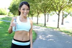 Pretty Asian Woman in Park Stock Photography