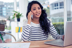 Pretty Asian woman on phone call Royalty Free Stock Photos
