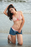 Pretty Asian woman  posing on the beach . Stock Images