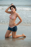 Pretty Asian woman  posing on the beach . Royalty Free Stock Images