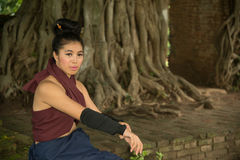 Pretty Asian woman posing in Thai ancient warriors dresses. Stock Photography