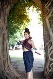 Pretty Asian woman posing in Thai ancient warriors dresses. Stock Photos