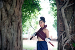 Pretty Asian woman posing in Thai ancient warriors dresses. Royalty Free Stock Photos