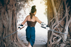 Pretty Asian woman posing in Thai ancient warriors dresses. Stock Photo