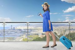 Pretty asian woman pulling suitcase royalty free stock photo
